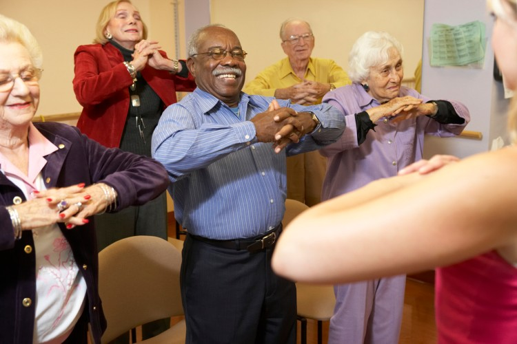 Nursing home residents in a stretching class