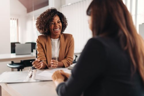 A smiling accountant meets with a client
