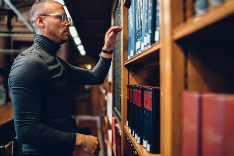 A historian conducts research in the library.
