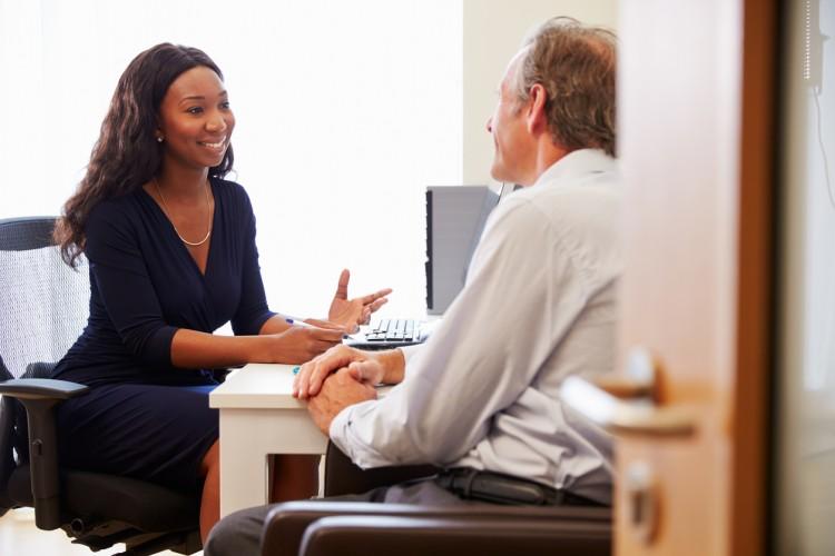 A human services specialist assists a client.