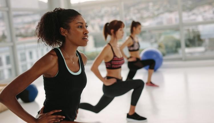 A recreation coordinator leads an exercise class