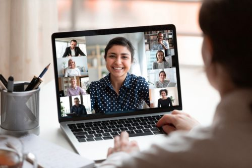 A business manager and team members in a virtual meeting