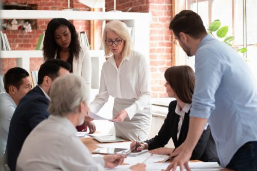 A corporate leadership team discusses strategy