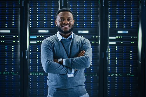 Smiling man standing in front of server