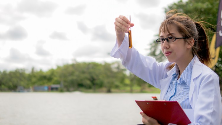 A hydrologist tests the water quality of a lake.