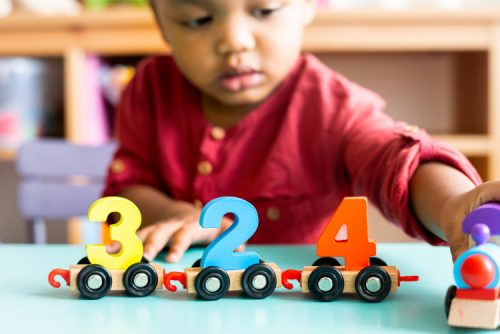 A child plays with number blocks