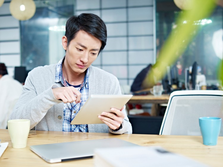 A marketing associate works on a tablet computer.