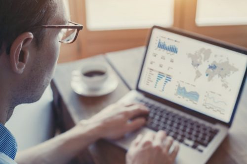 A business data analyst views a dashboard showing sales performance