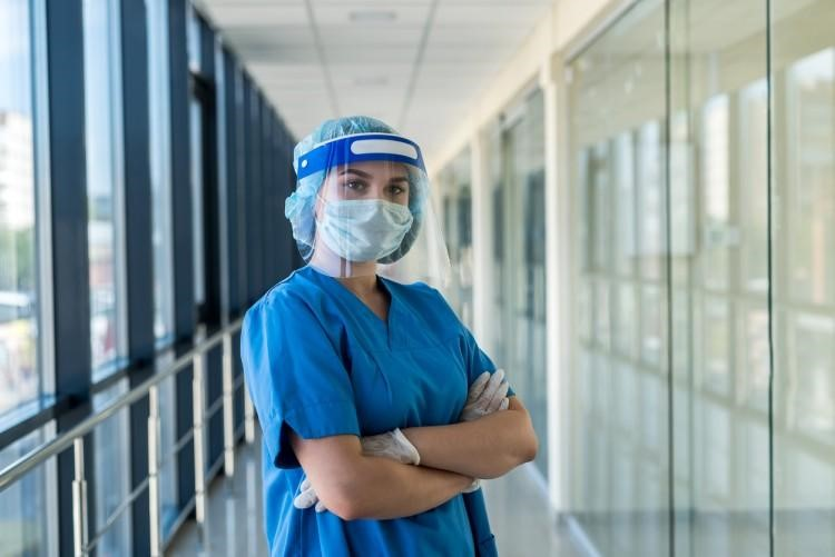 An infection control nurse wearing personal protective equipment.