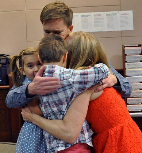 Marcy Bursac hugging family