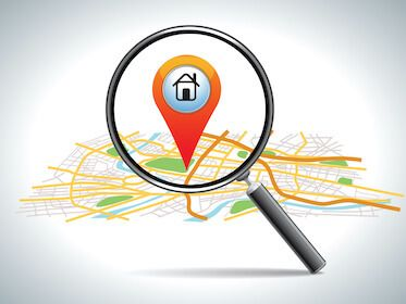 Image of magnifying glass looking at a map