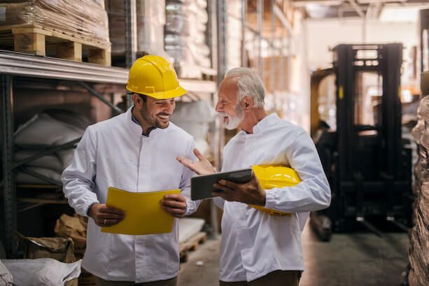 Image of two men in a warehouse talking