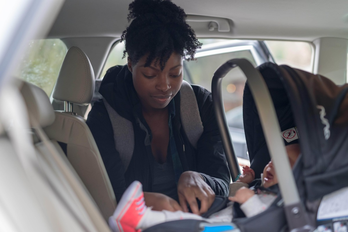 Blog2 mom putting baby in rear facing car seat min small