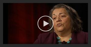 Video still of a woman speaking