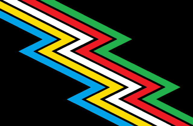 A black flag crossed diagonally from top left to bottom right by a zigzag band divided into parallel stripes of five colors: light blue, yellow, white, red, and green. There are narrow bands of black between the colors.