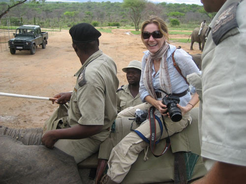 Elina Fuhrman riding an elephant in South Africa. Photo by Johnny Jet