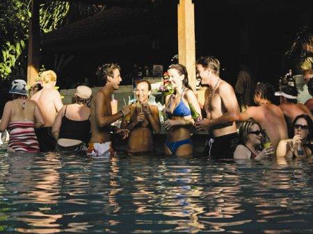 Singles enjoying the beach vacations scene at Bali's Bounty Hotel.