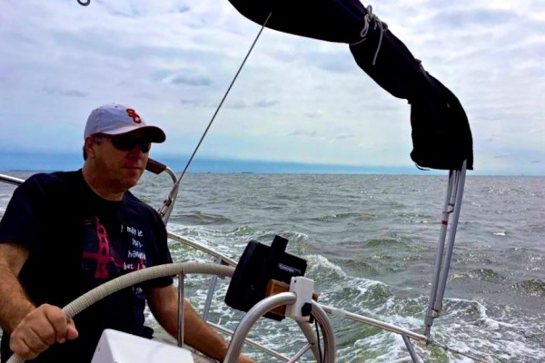 Charles McCool captaining a 36-foot sailboat in the Chesapeake Bay off the coast of Annapolis, VA.