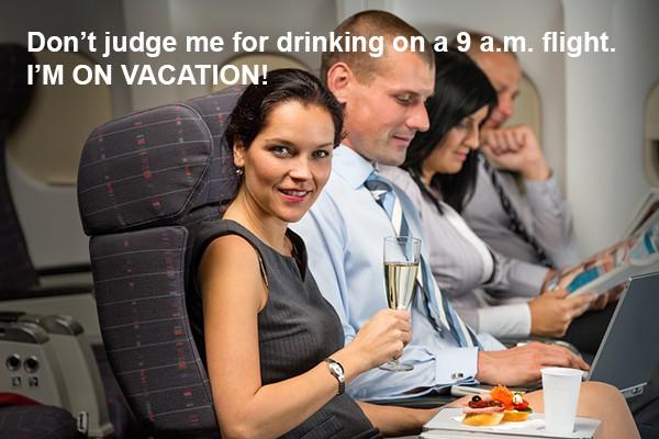 TSA-travel stock photos-drinking in flight