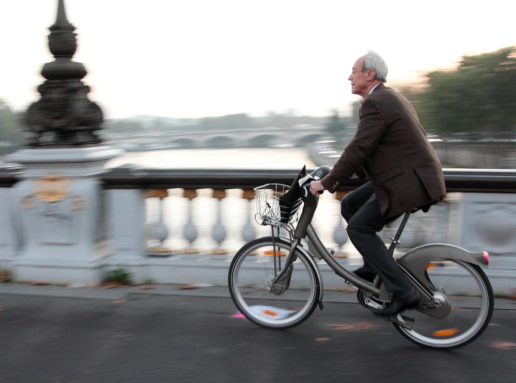 Man riding a Velib bike in Paris