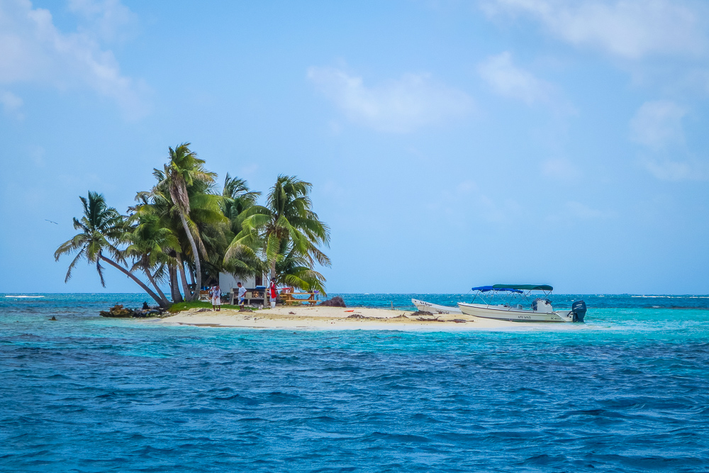 Belize Small Island with palm trees and boat