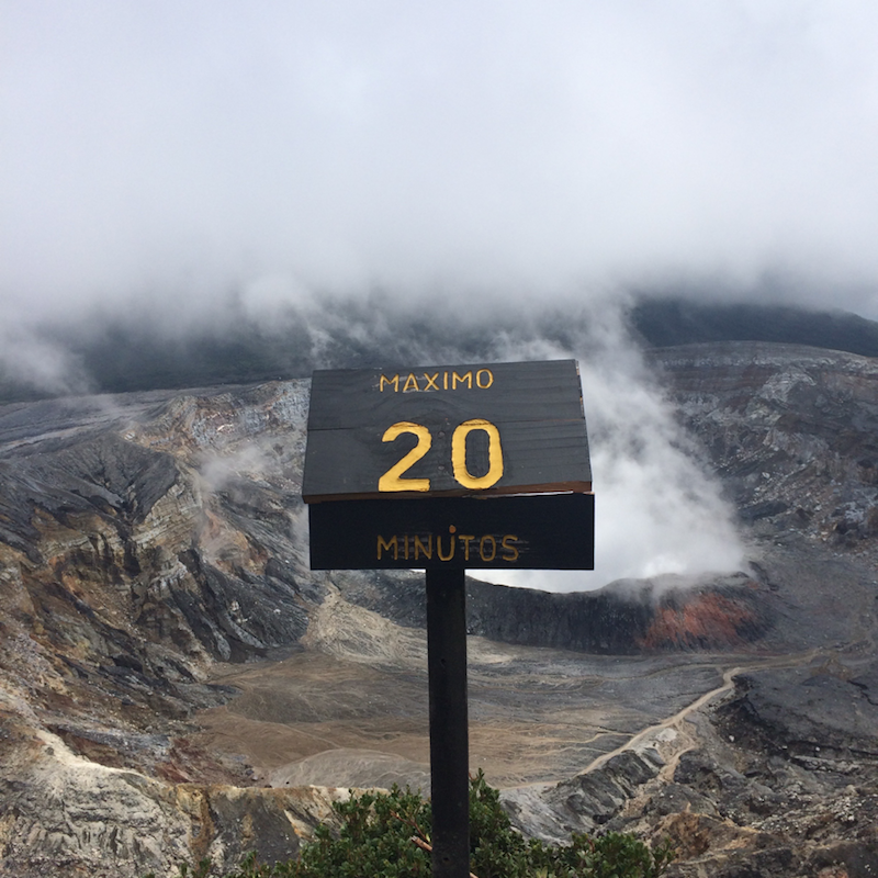 Signs posted near Poás volcano warn that 20 minutes breathing the noxious fumes is long enough.