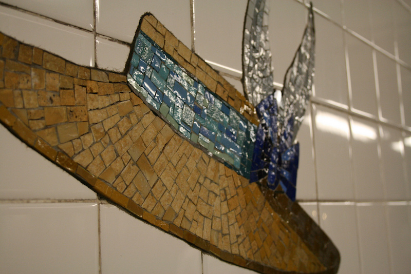 One of the mosaic tile hats at the 23rd street subway station
