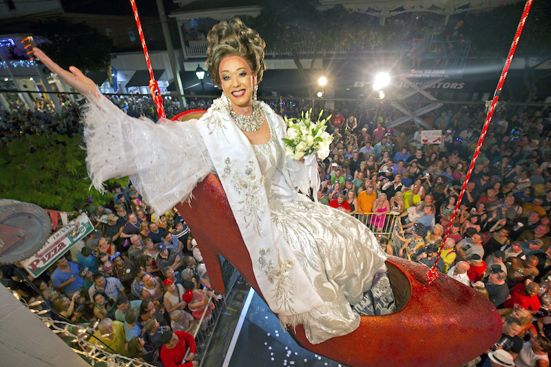 Female impersonator Gary Marion, known as Sushi, hangs in a giant replica of a woman's high heel shoe Thursday, Dec. 31, 2015, in Key West, Fla. | Photo courtesy of (Rob O'Neal/Florida Keys News Bureau/HO)