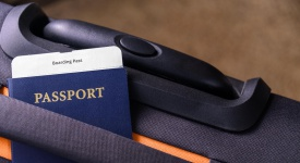 Passport and a boarding pass on a suitcase