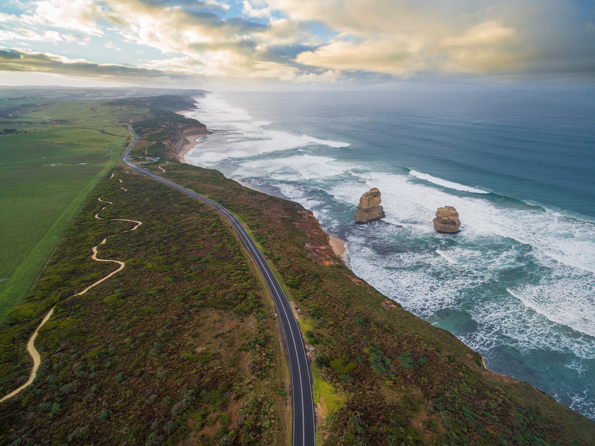 Aerial view of the Great Ocean Road with Gog and Magog rock formations.