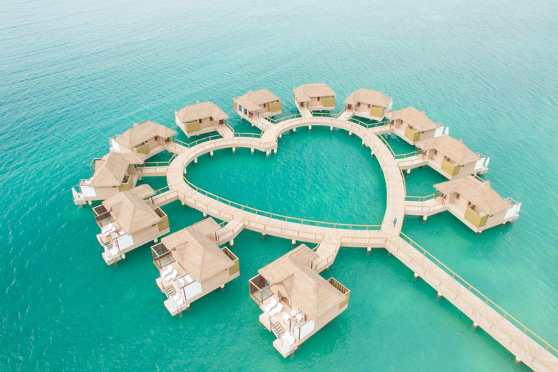 Heart shaped Jamaica Overwater bungalows in whitehouse jamaica -sandals resorts - GettingStamped.com