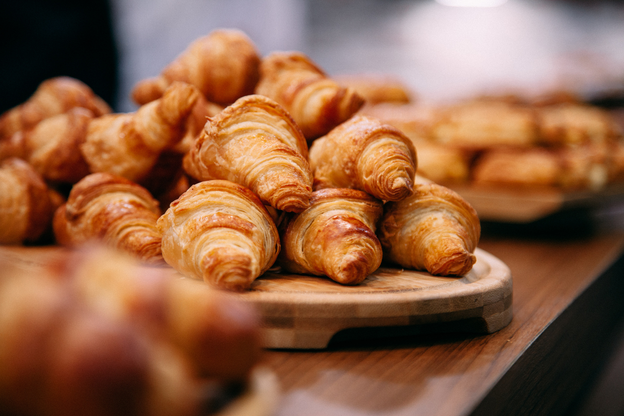 Rows of fresh baked French croissants ready to be sold