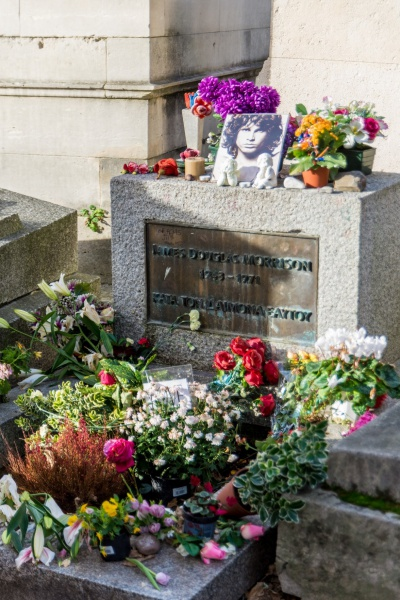 jim morrison's grave at the pere lechaise cemetary in paris