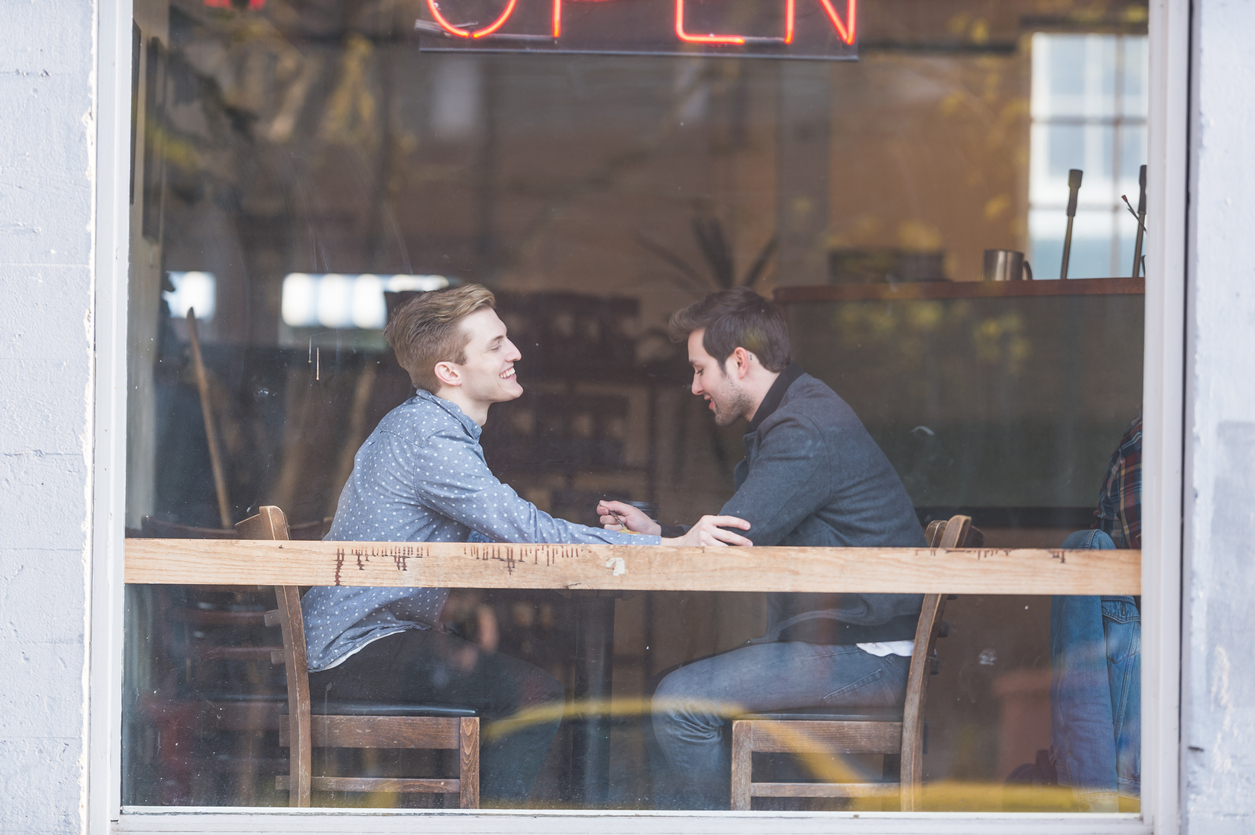 Male Couple Enjoying Each Other's Company at an Urban Coffeehouse in washington dc