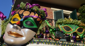 View of a balcony in New Orleans, Louisiana, USA, decorated for carnival celebration of Mardi Gras.