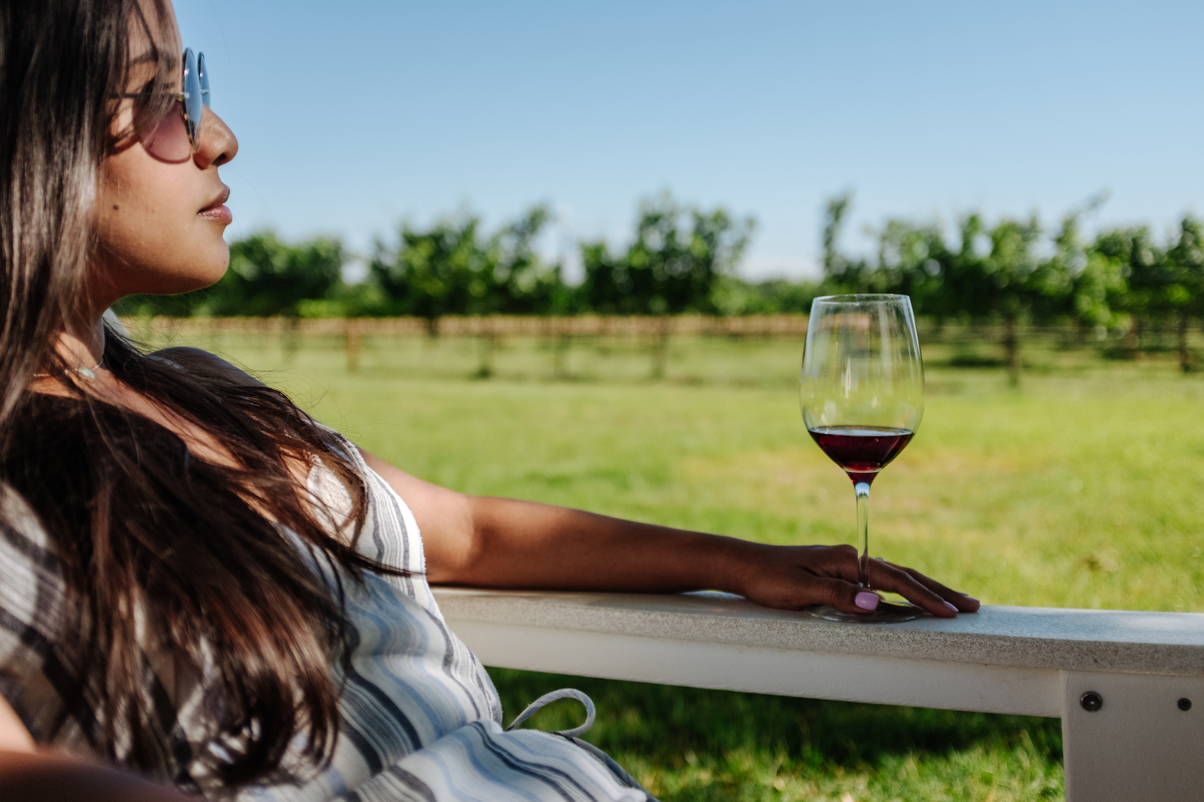 A young hispanic woman exploring the wineries and nature of Fredericksburg, TX.