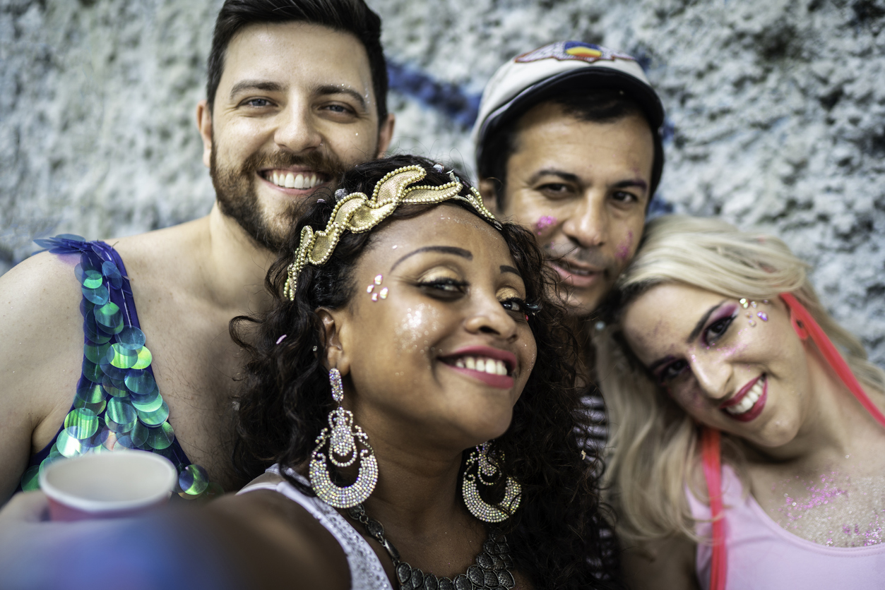 Friends having fun and taking a selfie at carnival party in Brazil
