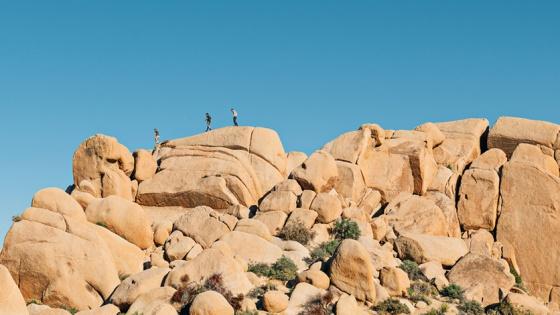 friends hiking on rocks