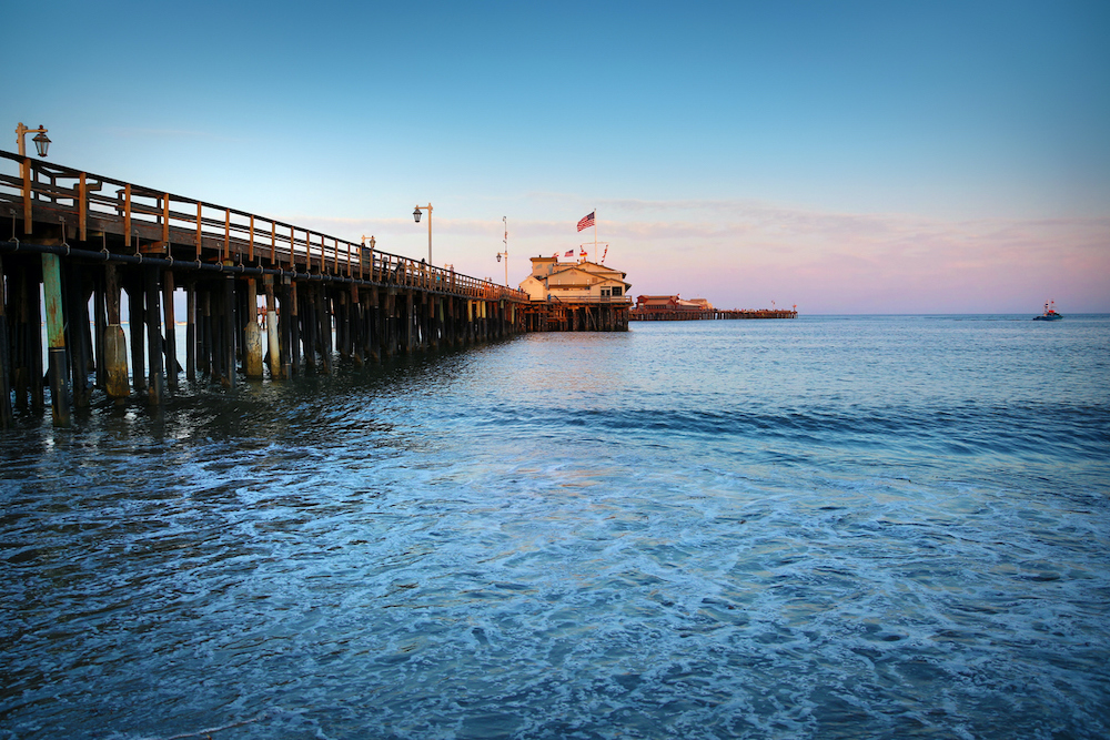 This is a photo of the Santa Barbara pier in California. There is a lot of space for copy or cropping.