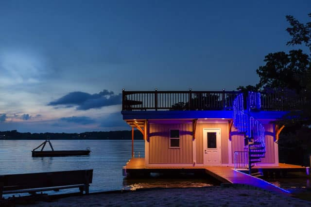 nighttime boat house with dock