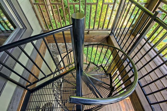 powder coated spiral staircase on lake house