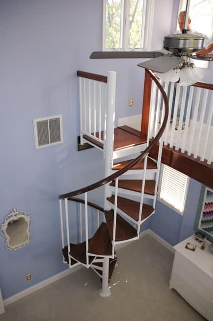 matching loft railing with wood handrail