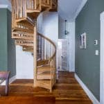 all wood spiral staircase dining room