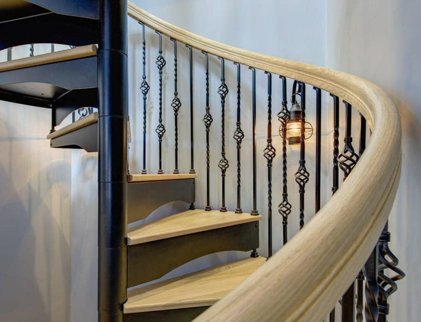 ornate spiral stair with wood accents