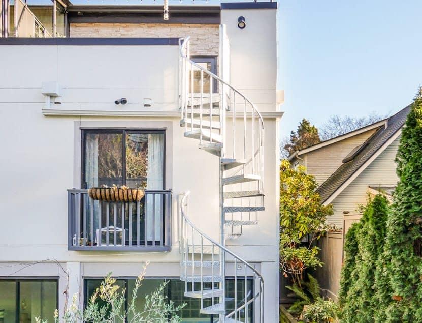 modern multistory deck with galvanized spiral stair