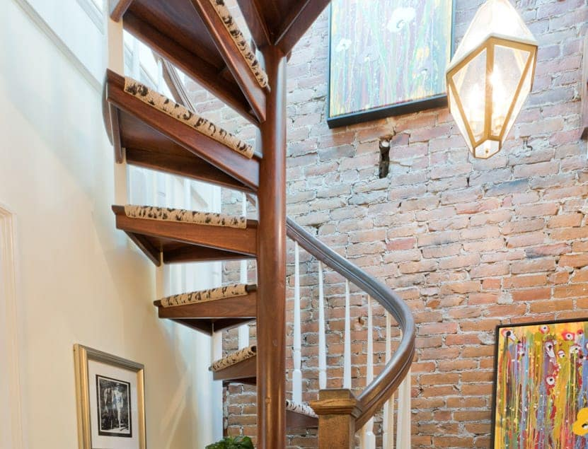 all wood spiral staircase with custom spindles