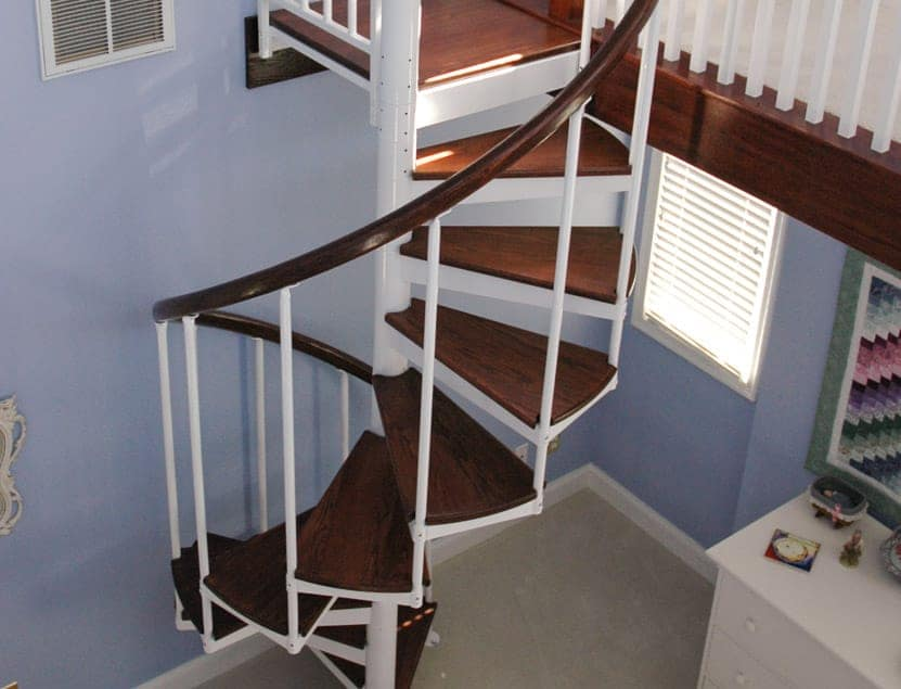 painted steel spiral stair with wood accents