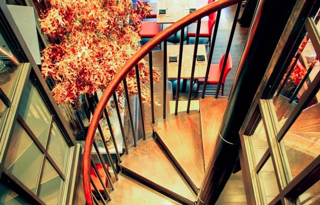 classic steel spiral stair with solid wood steps