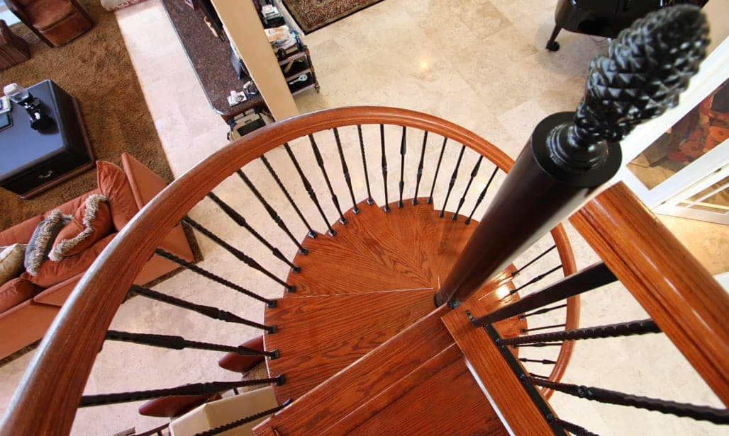 steel spiral stair with solid wood steps and platform