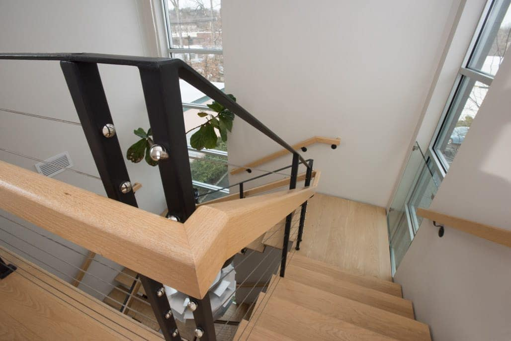 solid wood handrail and cable railing detail shot